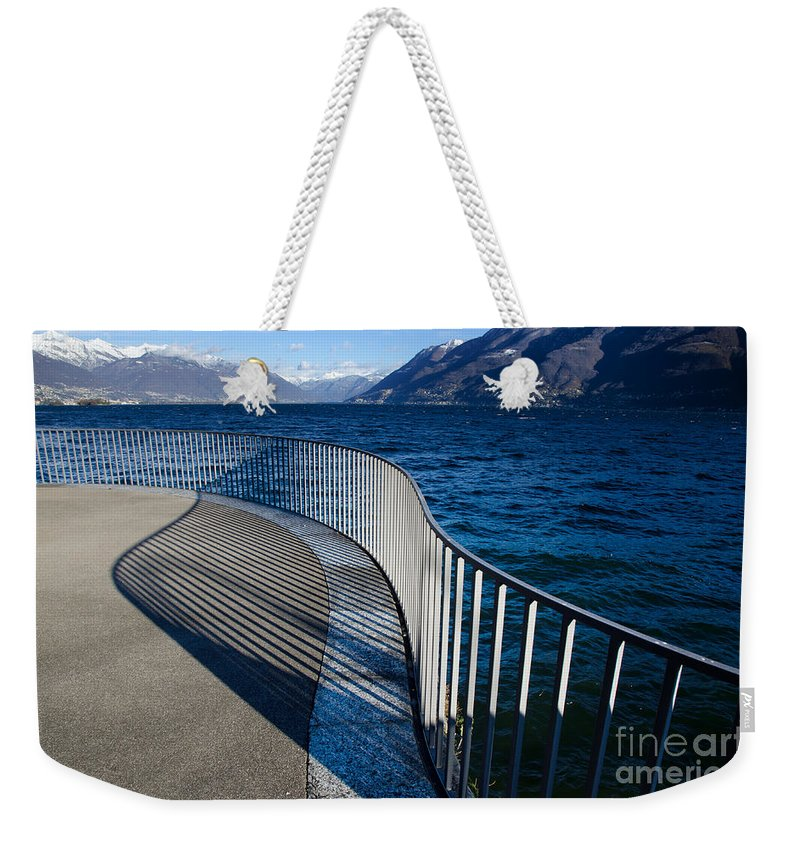 Banister Weekender Tote Bag featuring the photograph Fence With Shadow by Mats Silvan