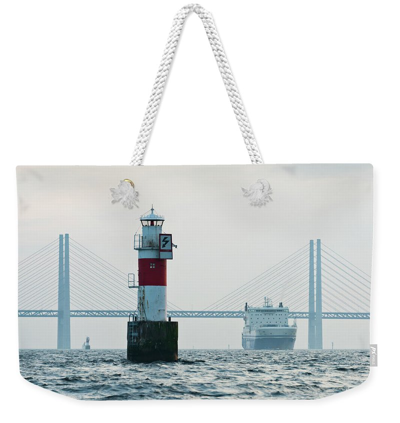 Copenhagen Weekender Tote Bag featuring the photograph Ferry On Sea, Oresund Bridge In by Johner Images