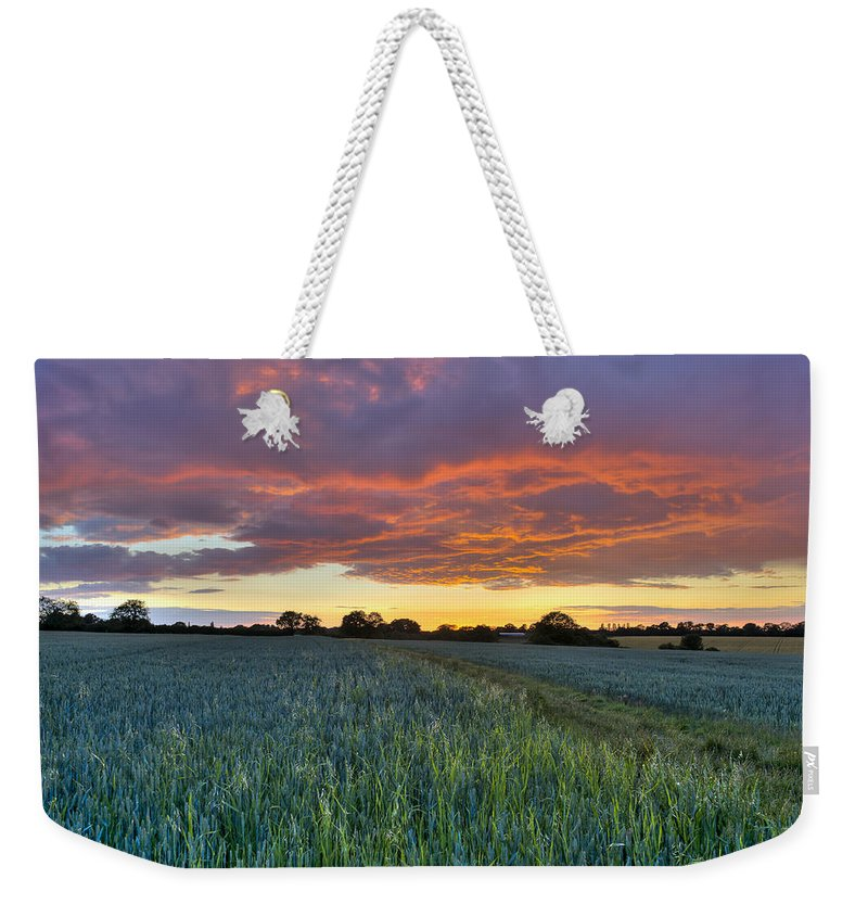 Sunset Weekender Tote Bag featuring the photograph Field At Sunset by Gary Eason