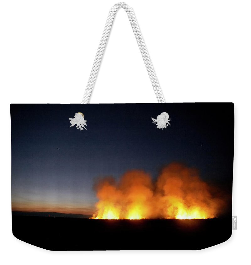 Africa Weekender Tote Bag featuring the photograph Field Fire. Nchalo, Shire Walley by Kennet Havgaard