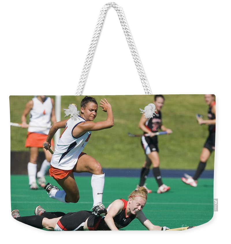 University Of Virginia Weekender Tote Bag featuring the photograph Field Hockey Hurdle by Jason O Watson