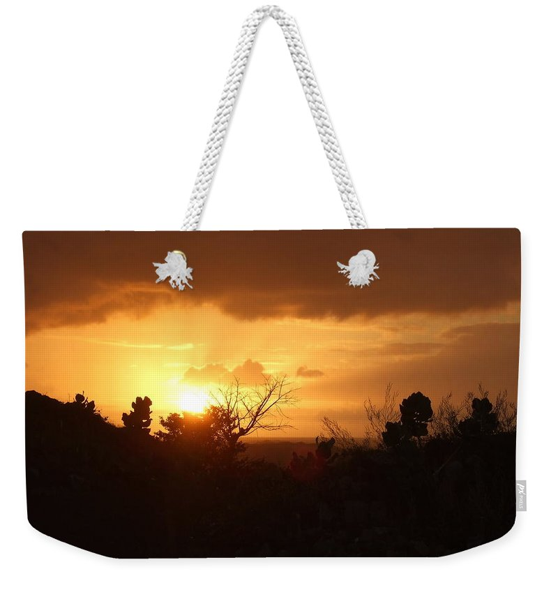 Weekender Tote Bag featuring the photograph Fiery Sky by Katerina Naumenko