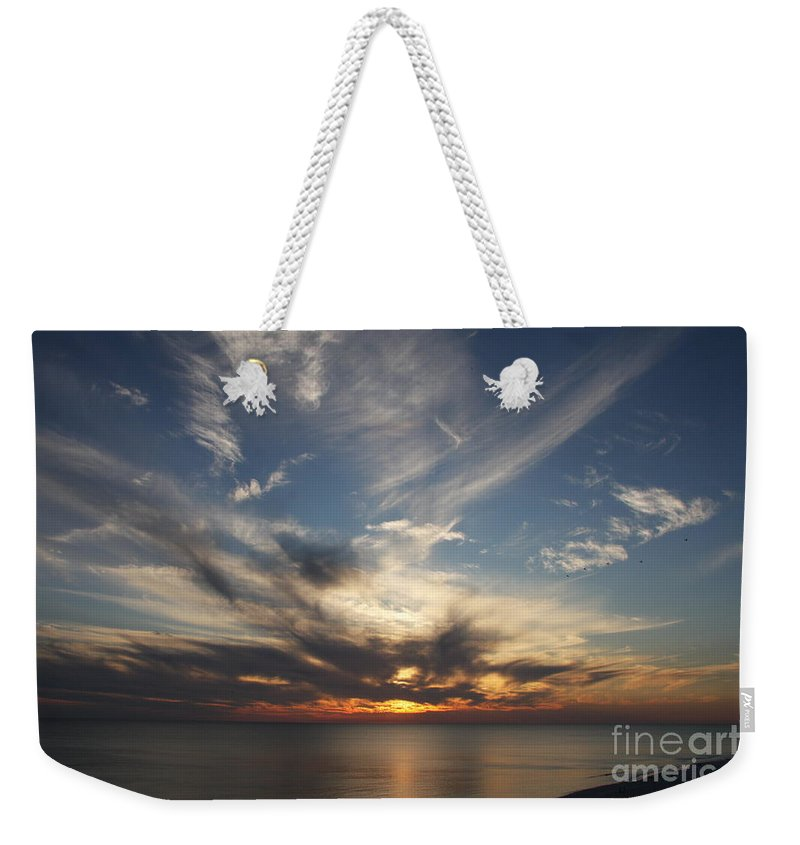 Sunset Weekender Tote Bag featuring the photograph Fiery Sunset Skys by Christiane Schulze Art And Photography