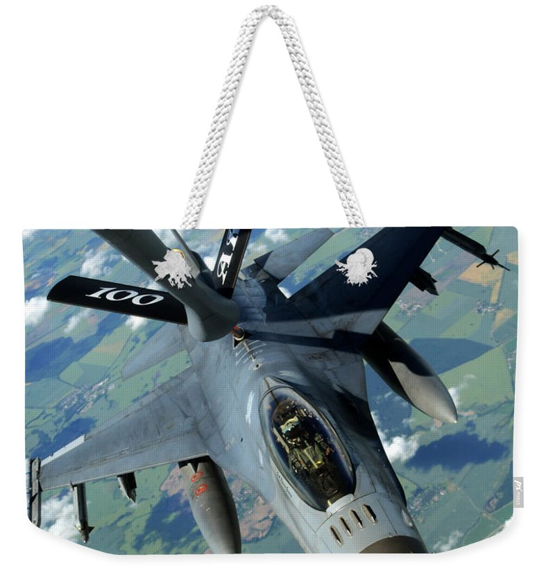 Weekender Tote Bag featuring the photograph Fill Her Up Please by Paul Fearn