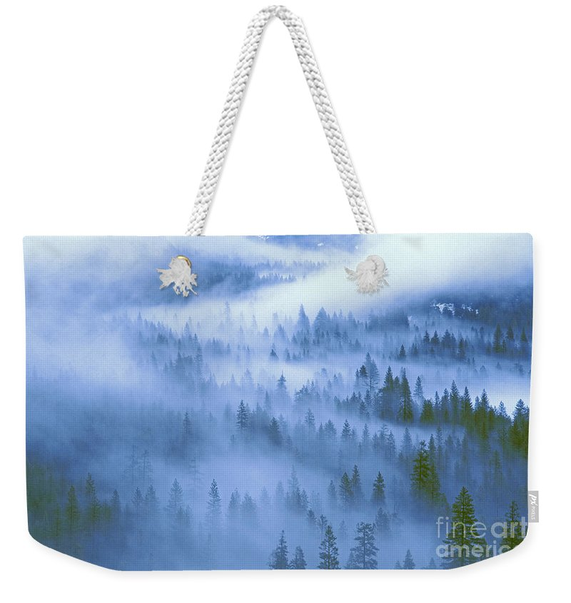 North America Weekender Tote Bag featuring the photograph Fir Trees Shrouded In Fog In Yosemite Valley by Dave Welling
