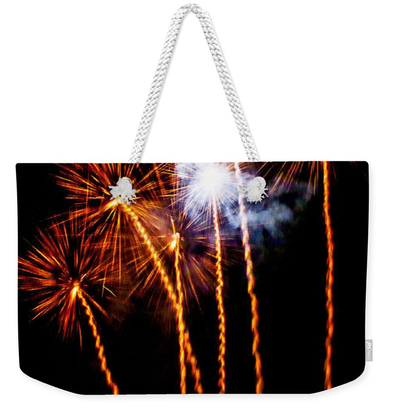 Fireworks Weekender Tote Bag featuring the photograph Fire Dandelion Bouquet by Weston Westmoreland
