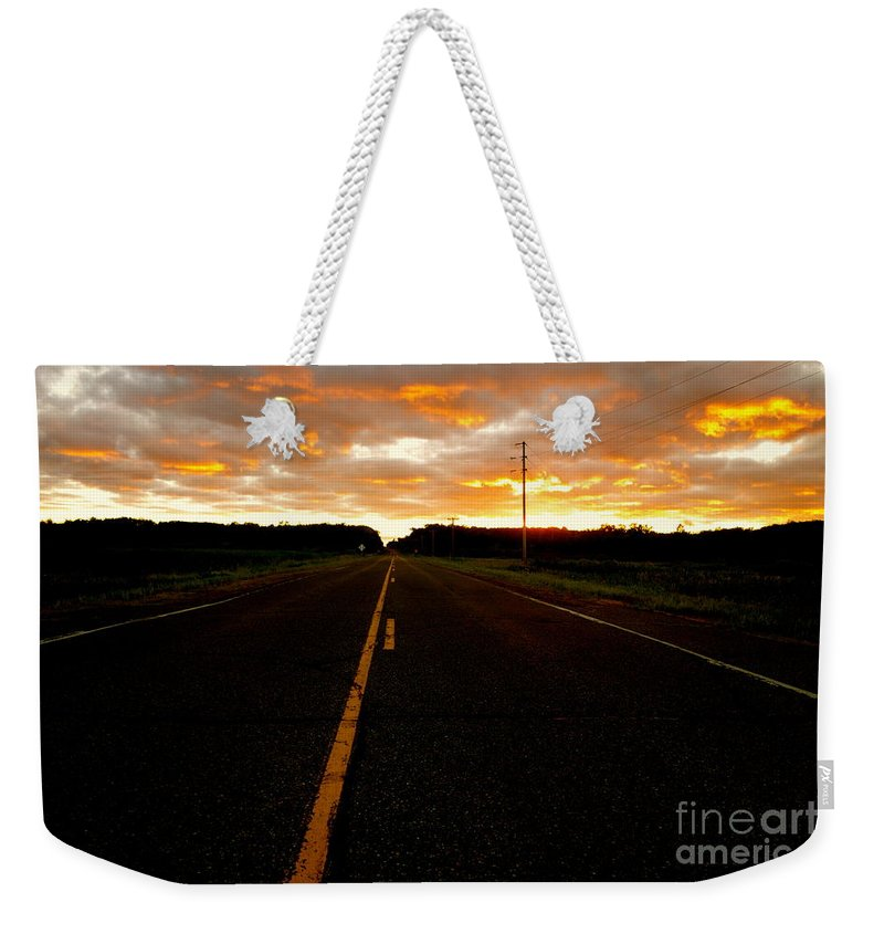 Road Weekender Tote Bag featuring the photograph Fire In The Sky by Jacqueline Athmann