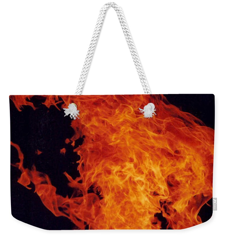 Flames Of A Large Camp Fire Weekender Tote Bag featuring the photograph Fire Man by Jeffery L Bowers