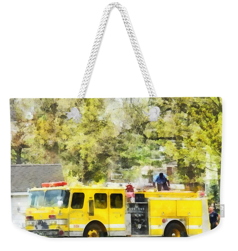 Firehouse Weekender Tote Bag featuring the photograph Firemen - Back At The Firehouse by Susan Savad