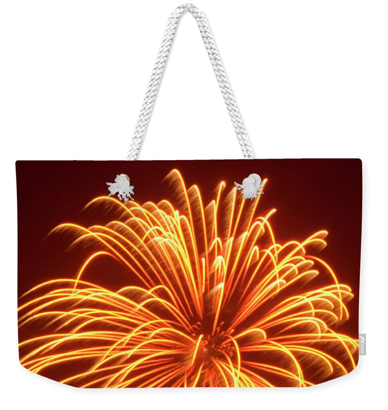 Orange Color Weekender Tote Bag featuring the photograph Fireworks by Dennis Mccoleman