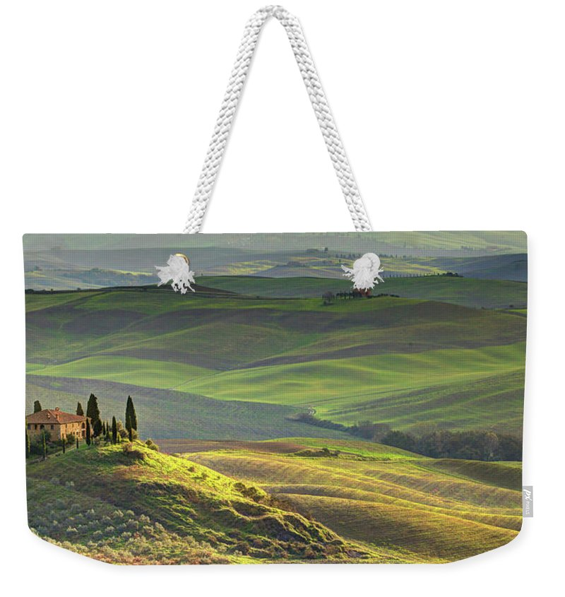 Scenics Weekender Tote Bag featuring the photograph First Light In Tuscany by Maurice Ford