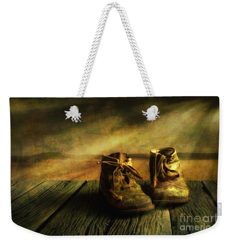 Art Weekender Tote Bag featuring the photograph First Shoes by Veikko Suikkanen