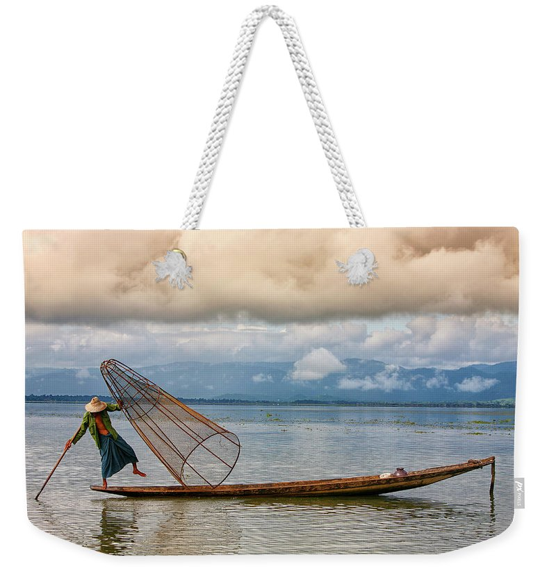 Adult Weekender Tote Bag featuring the photograph Fishermen In The Inle Lake. Myanmar by David Santiago Garcia