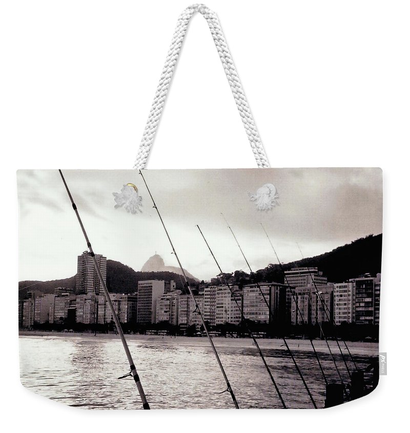 Fishing Weekender Tote Bag featuring the photograph Fishing In Rio by Glenn Aker