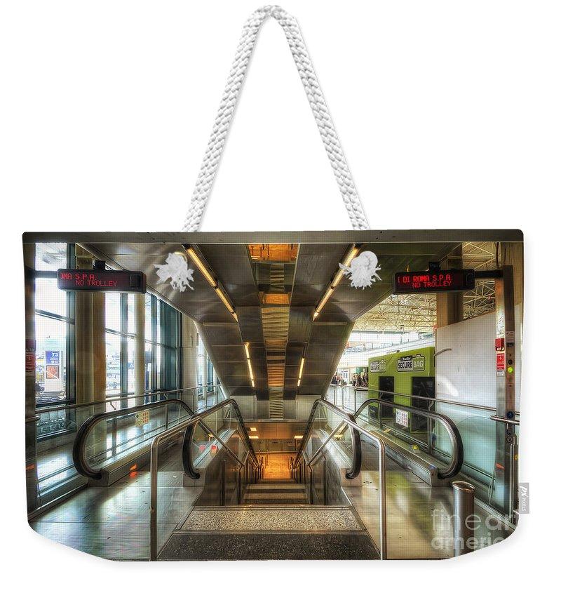 Yhun Suarez Weekender Tote Bag featuring the photograph Fiumicino Airport Escalator by Yhun Suarez