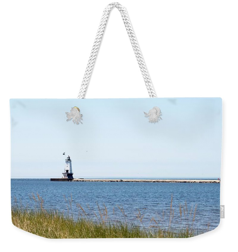 Ludington Weekender Tote Bag featuring the photograph Flags In The Wind by Linda Kerkau
