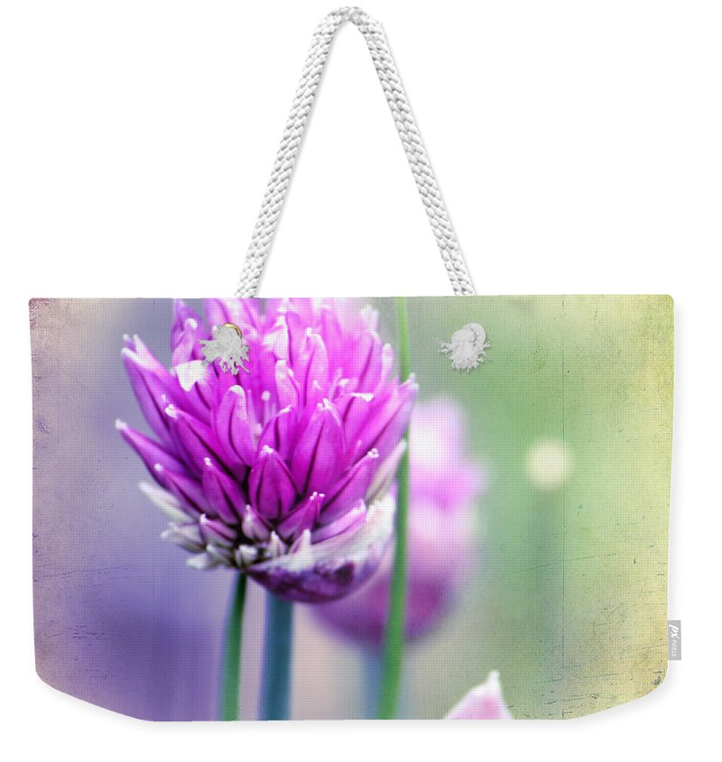 Flowering Chives Weekender Tote Bag featuring the photograph Fleurs De Oboulette by Chris Armytage