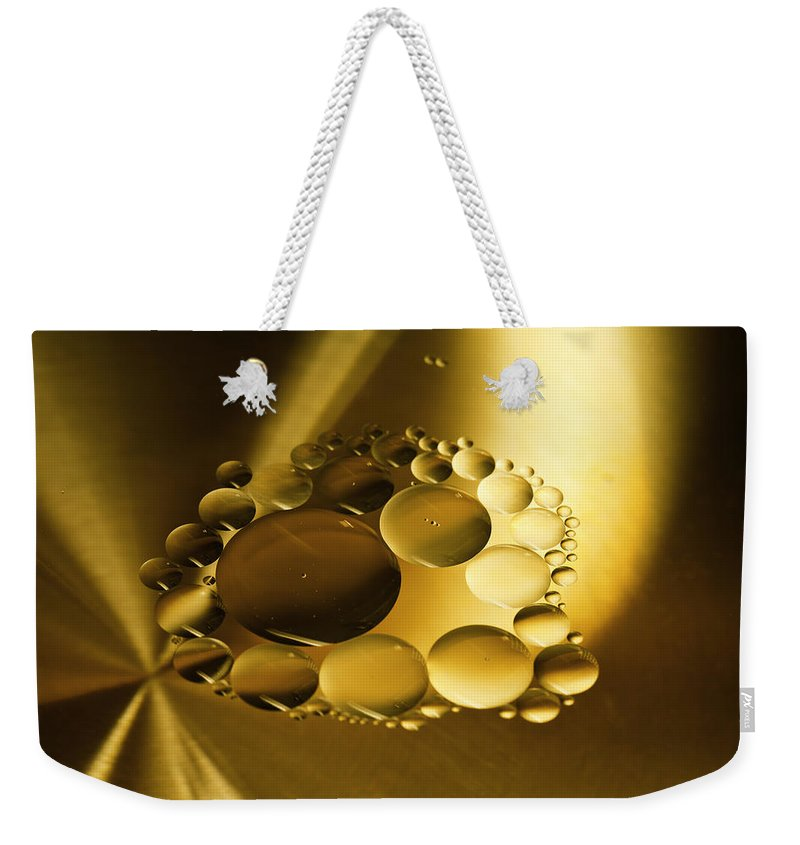 Oil Weekender Tote Bag featuring the photograph Floating Beauty by Angela Stanton