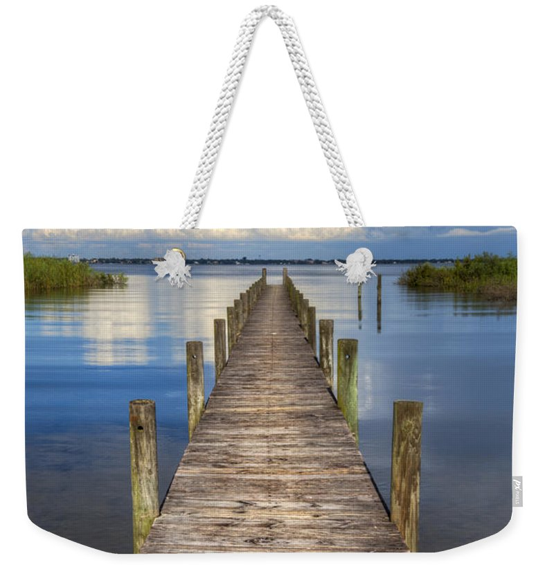 Clouds Weekender Tote Bag featuring the photograph Floating by Debra and Dave Vanderlaan