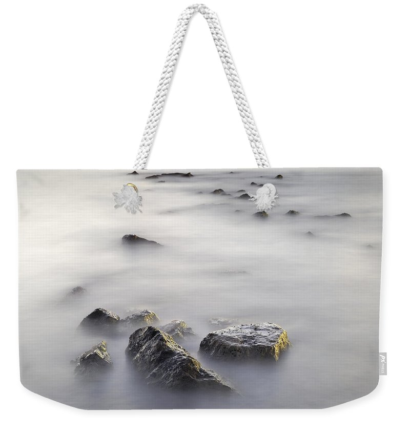 Seascape Weekender Tote Bag featuring the photograph Floating In The Sea by Guido Montanes Castillo