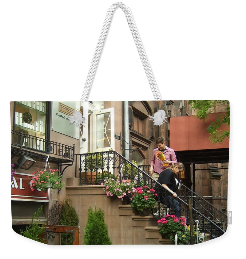 Weekender Tote Bag featuring the photograph Flower Shop by Katerina Naumenko