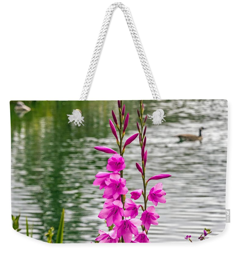 Bird Weekender Tote Bag featuring the photograph Flowers At The Lake by Kate Brown