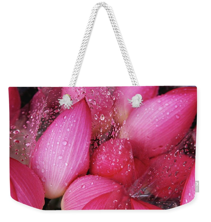 Retail Weekender Tote Bag featuring the photograph Flowers For Sale At Yuen Po Street by Richard I'anson