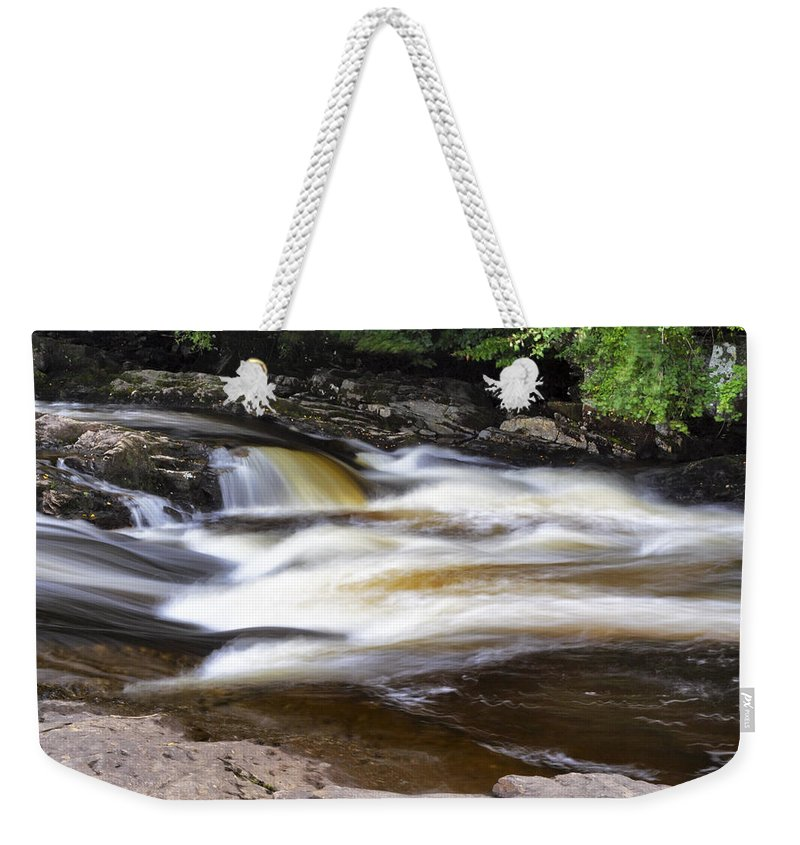 Falls Of Dochart Weekender Tote Bag featuring the photograph Flowing And Cascading At The Falls Of Dochart - Killin Scotland by Jason Politte