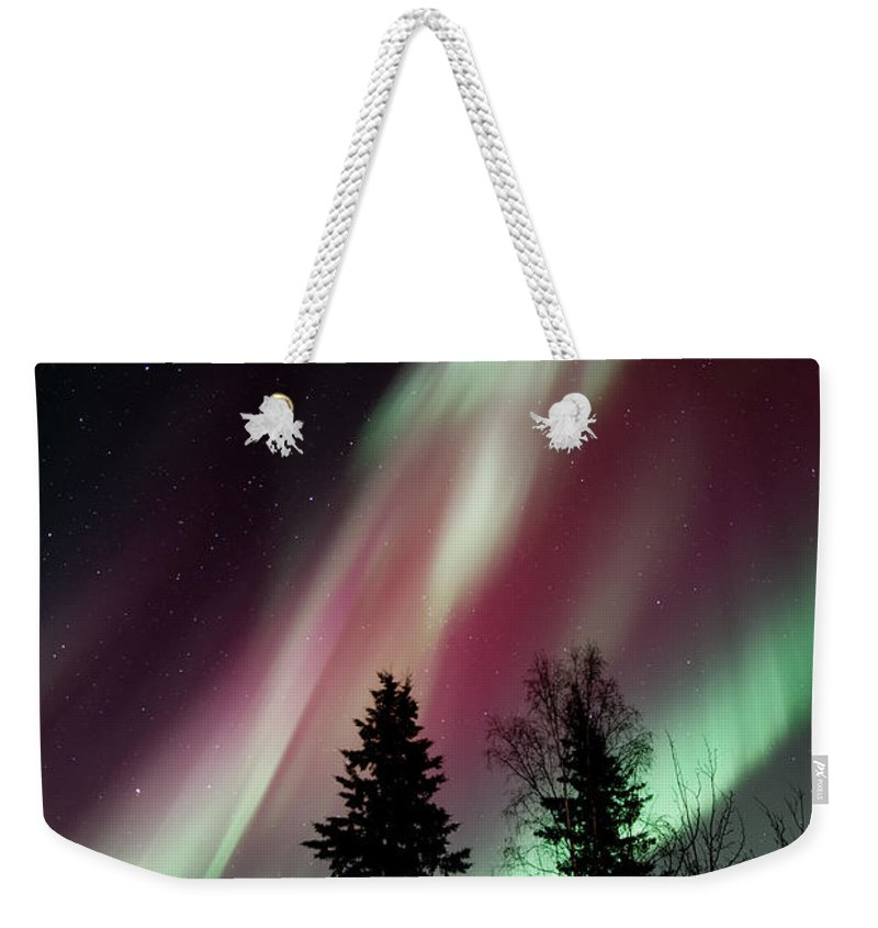 Northern Light Weekender Tote Bag featuring the photograph Flowing Colours by Priska Wettstein