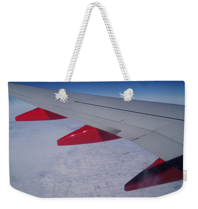 Red Weekender Tote Bag featuring the photograph Fly Away With Me by Jennifer E Doll