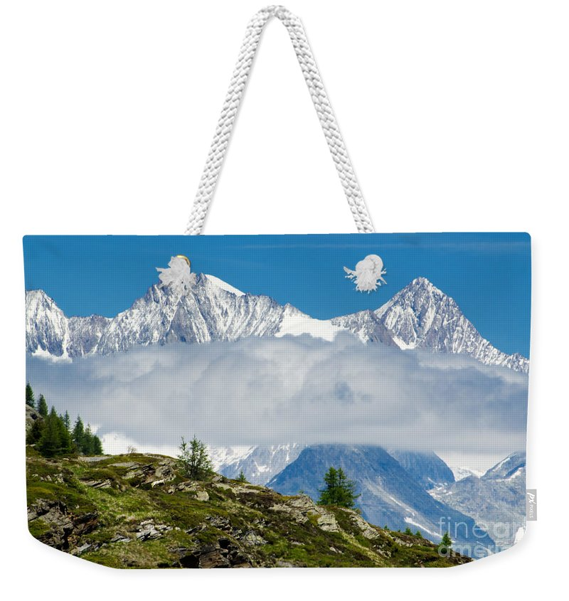 Mountains Weekender Tote Bag featuring the photograph Flying Cloud by Mats Silvan