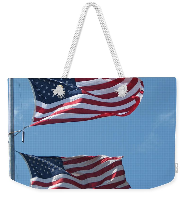 Flag Weekender Tote Bag featuring the photograph Flying High by Ray Konopaske