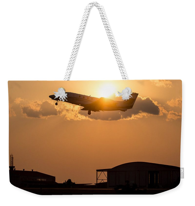 Aircraft Weekender Tote Bag featuring the photograph Flying Home by Paul Job