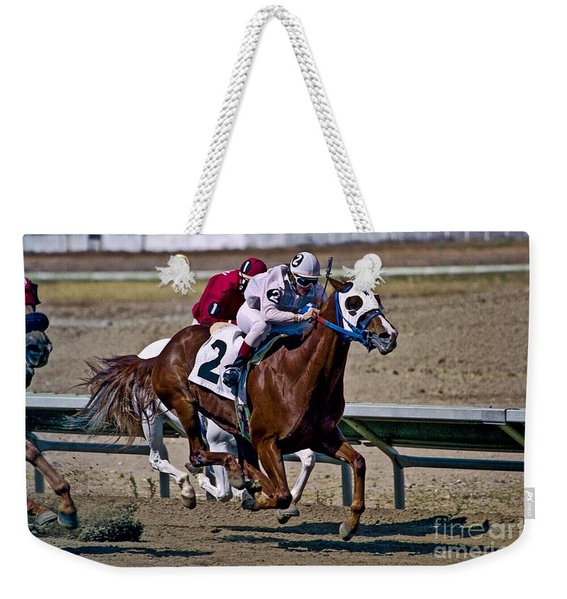Racing Weekender Tote Bag featuring the photograph Flying Hooves by Kathy McClure