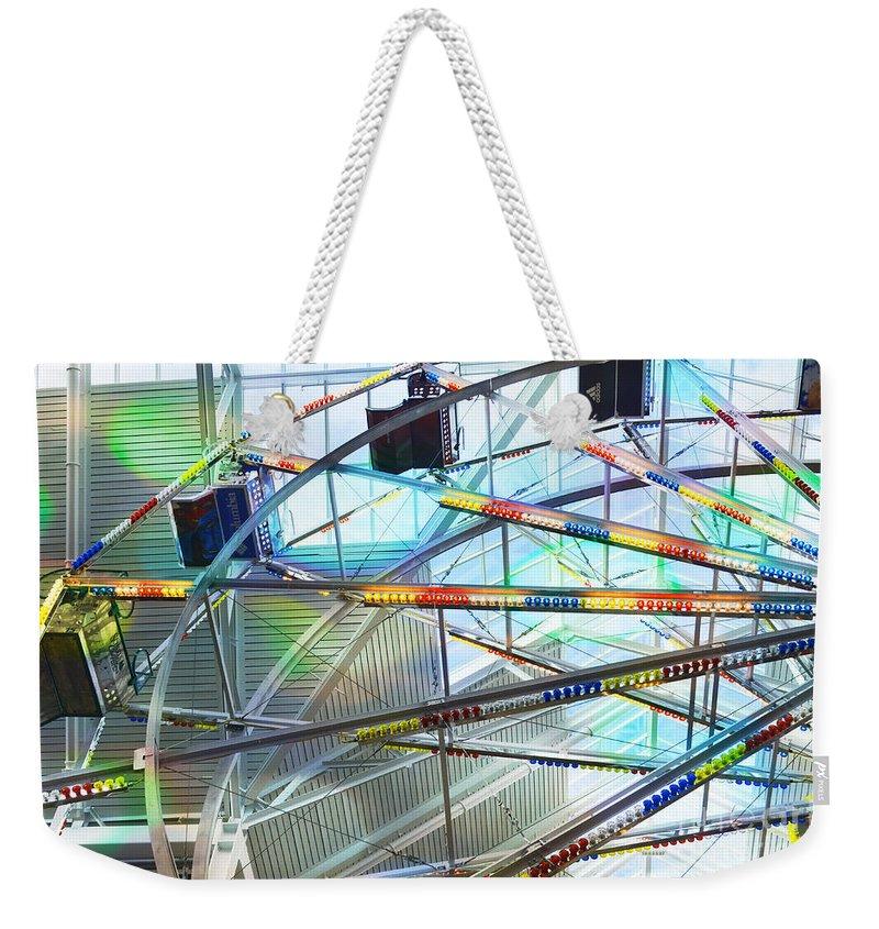 Flying Inside Ferris Wheel Weekender Tote Bag featuring the photograph Flying Inside Ferris Wheel by Luther Fine Art