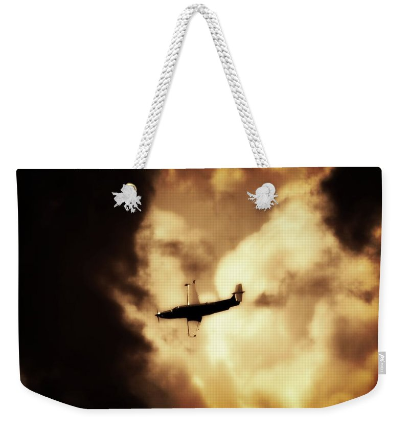 Pilatus Pc 12 Weekender Tote Bag featuring the photograph Flying Into The Storm by Paul Job