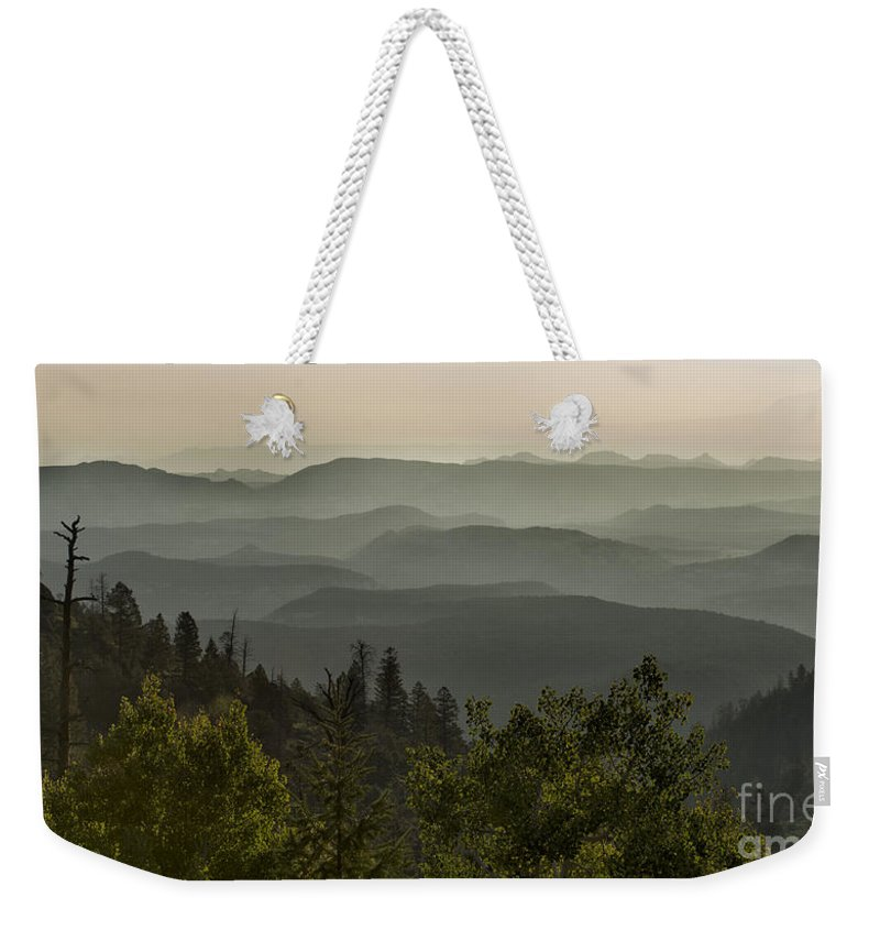 Southwest Weekender Tote Bag featuring the photograph Foggy Morning Over Waterpocket Fold by Sandra Bronstein