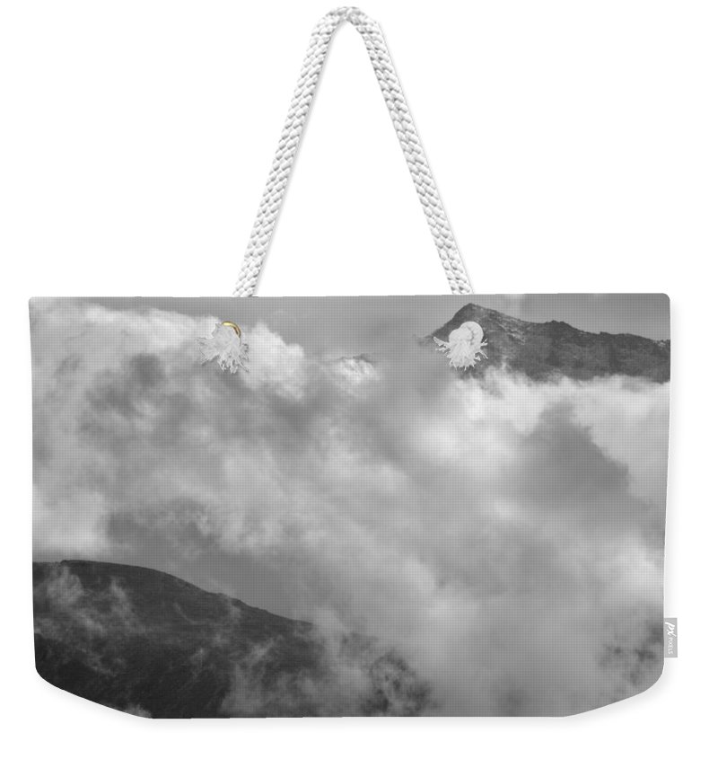 Black And White Weekender Tote Bag featuring the photograph Sky And Earth by Guido Montanes Castillo