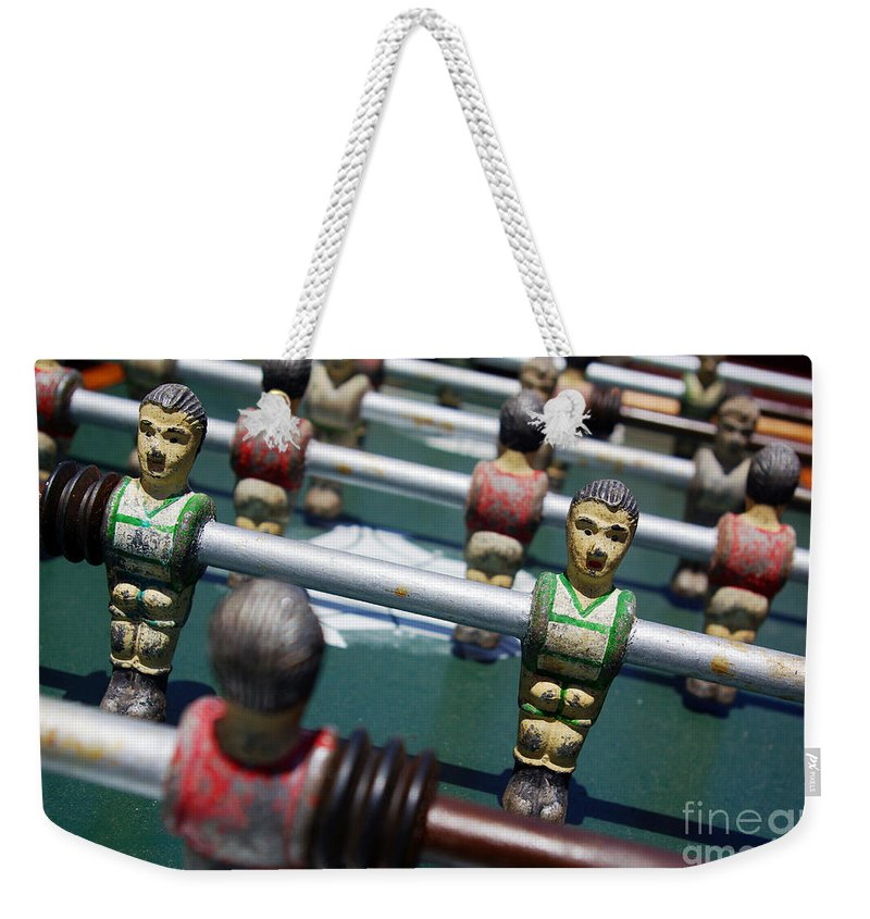 Action Weekender Tote Bag featuring the photograph Foosball by Carlos Caetano