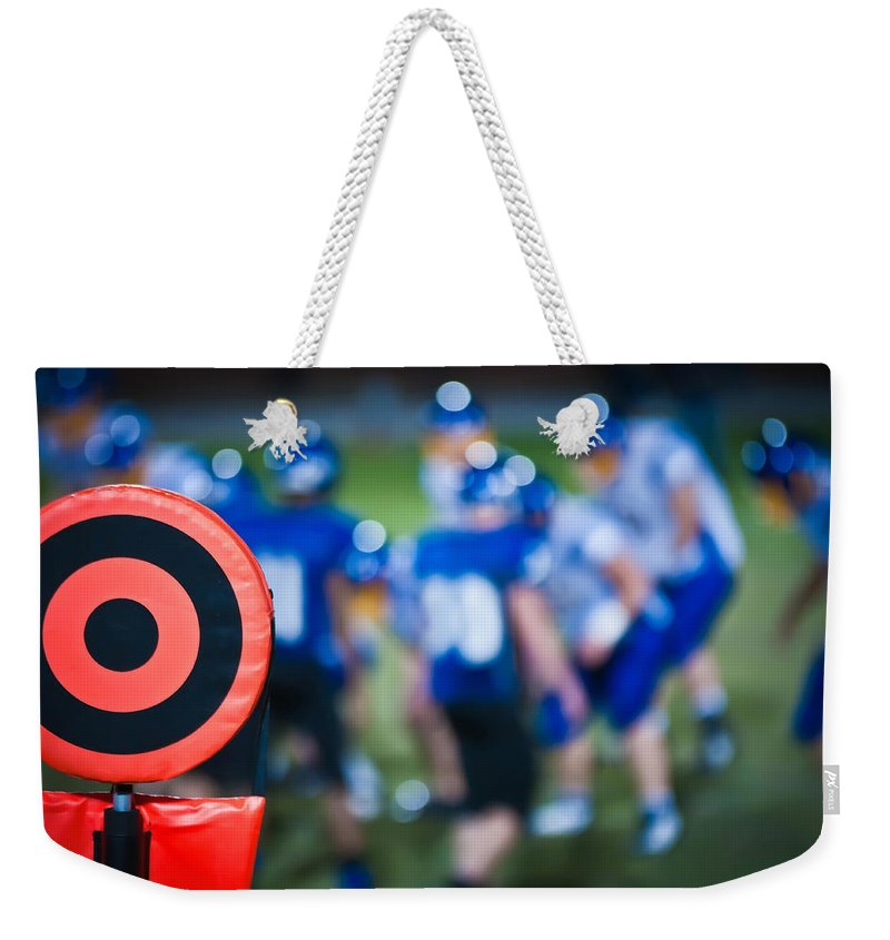 People Weekender Tote Bag featuring the photograph Football Sideline Marker by Alex Grichenko