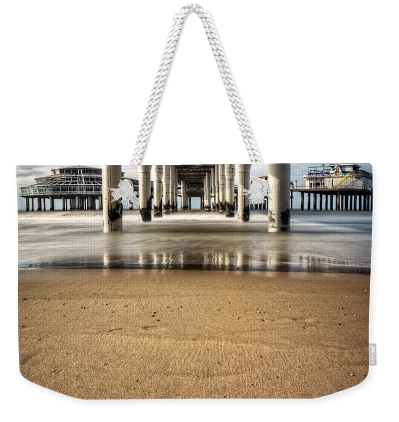 Piers Weekender Tote Bag featuring the photograph Footprints In The Sand by Dave Bowman
