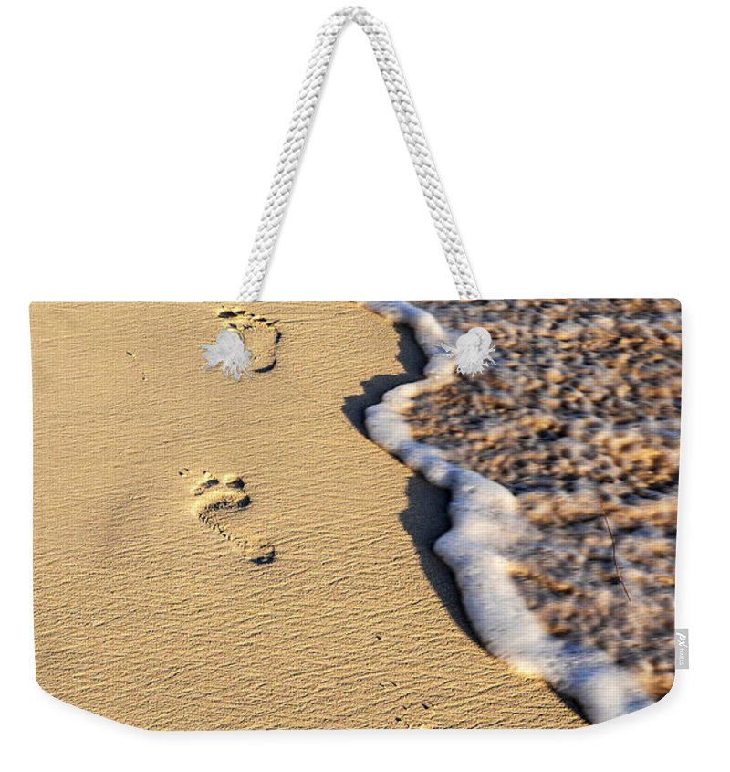 Footprints Weekender Tote Bag featuring the photograph Footprints On Beach by Elena Elisseeva