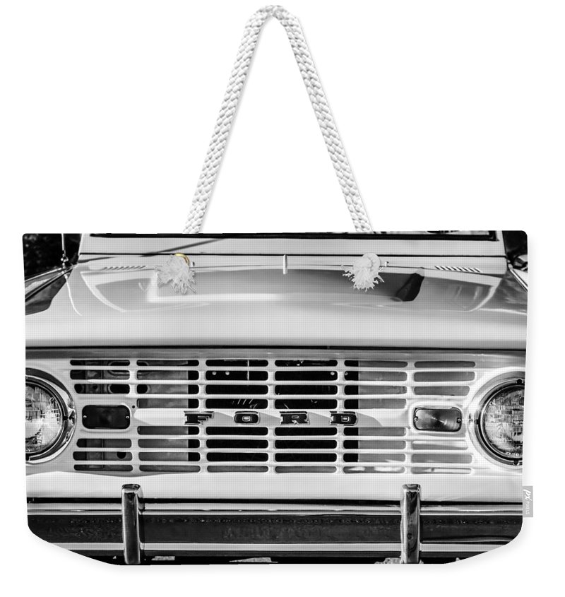 Ford Bronco Grille Emblem Weekender Tote Bag featuring the photograph Ford Bronco Grille Emblem -0014bw by Jill Reger