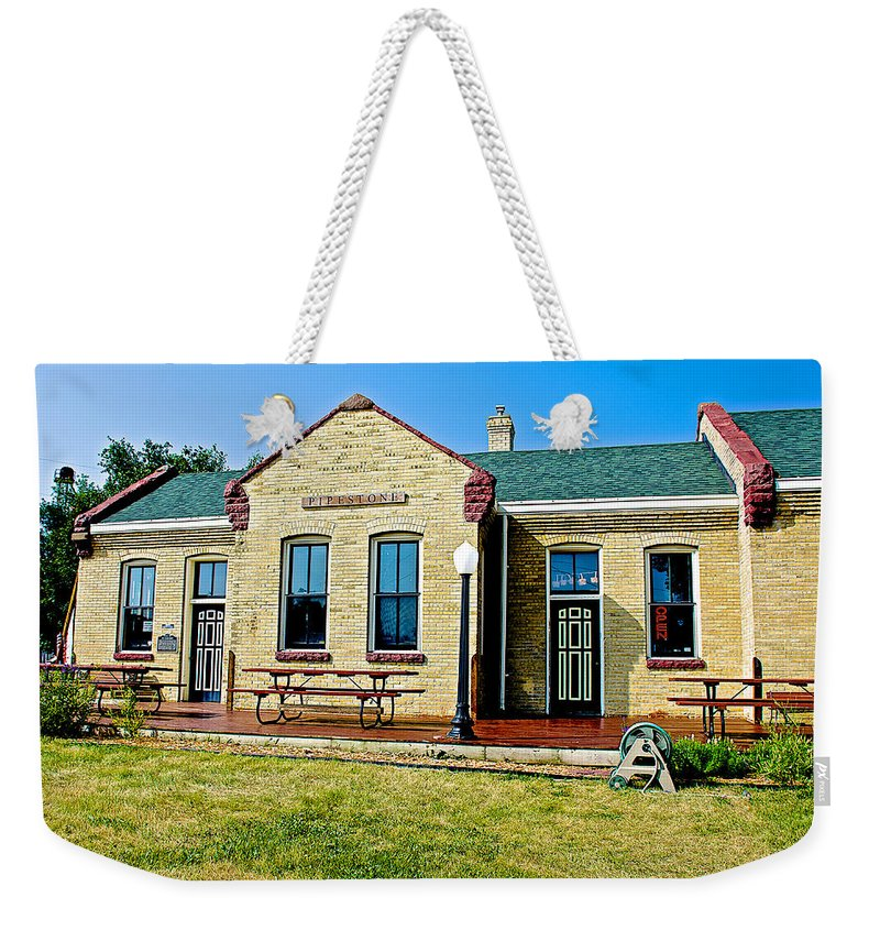 Former Rock Island Line Railroad Depot In Pipestone Weekender Tote Bag featuring the photograph Former Rock Island Line Railroad Depot In Pipestone-minnesota by Ruth Hager