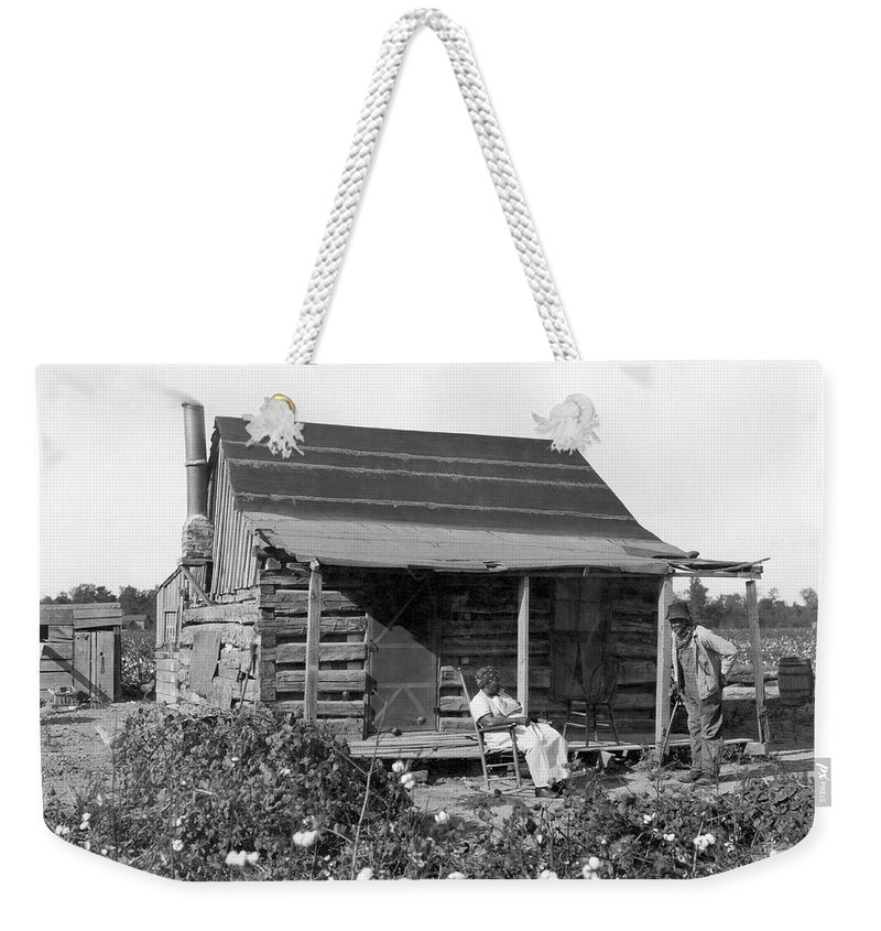 1800s Weekender Tote Bag featuring the photograph Former Slaves At Their Cabin by Underwood Archives