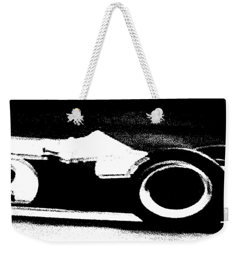 Formula 1 Racing Weekender Tote Bag featuring the photograph Formula 1 Racer In Action by George Pedro