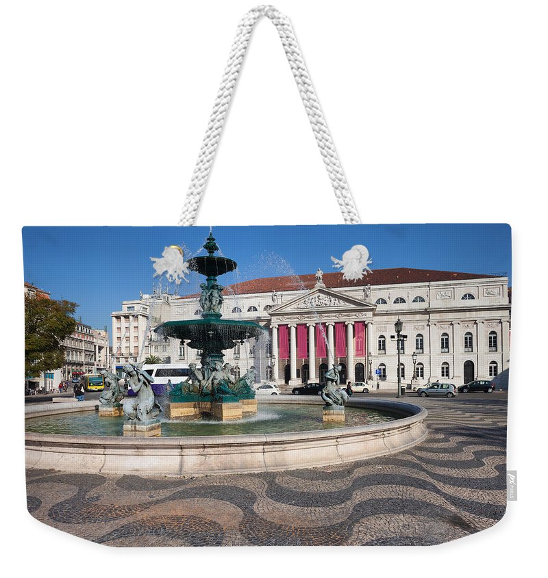 Lisbon Weekender Tote Bag featuring the photograph Fountain And Theater On Rossio Square In Lisbon by Artur Bogacki