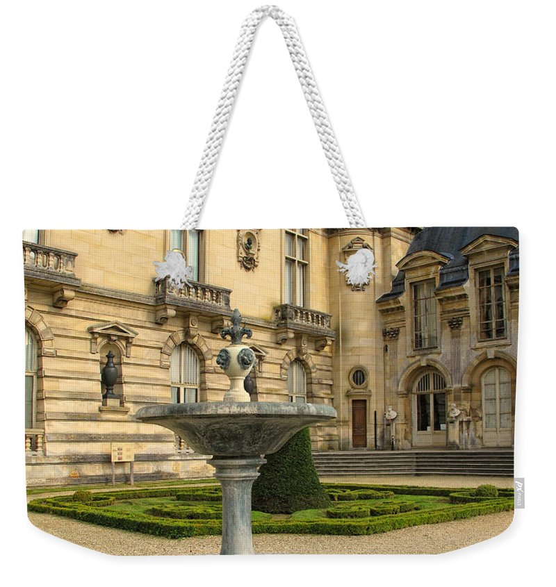 Fountain Weekender Tote Bag featuring the photograph Fountain At Chateau De Chantilly by Dave Mills
