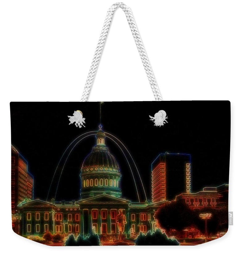 Weekender Tote Bag featuring the photograph Fountain At City Garden In Neon Framed by Jessica Flieg