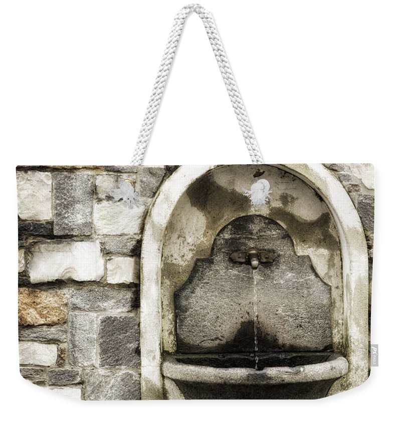 Switzerland Weekender Tote Bag featuring the photograph Fountain Of Ascona by Timothy Hacker